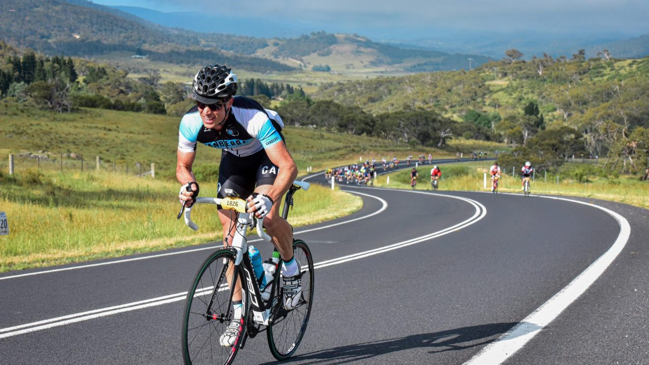 A road cyclist is riding up Perisher, NSW - Australia.