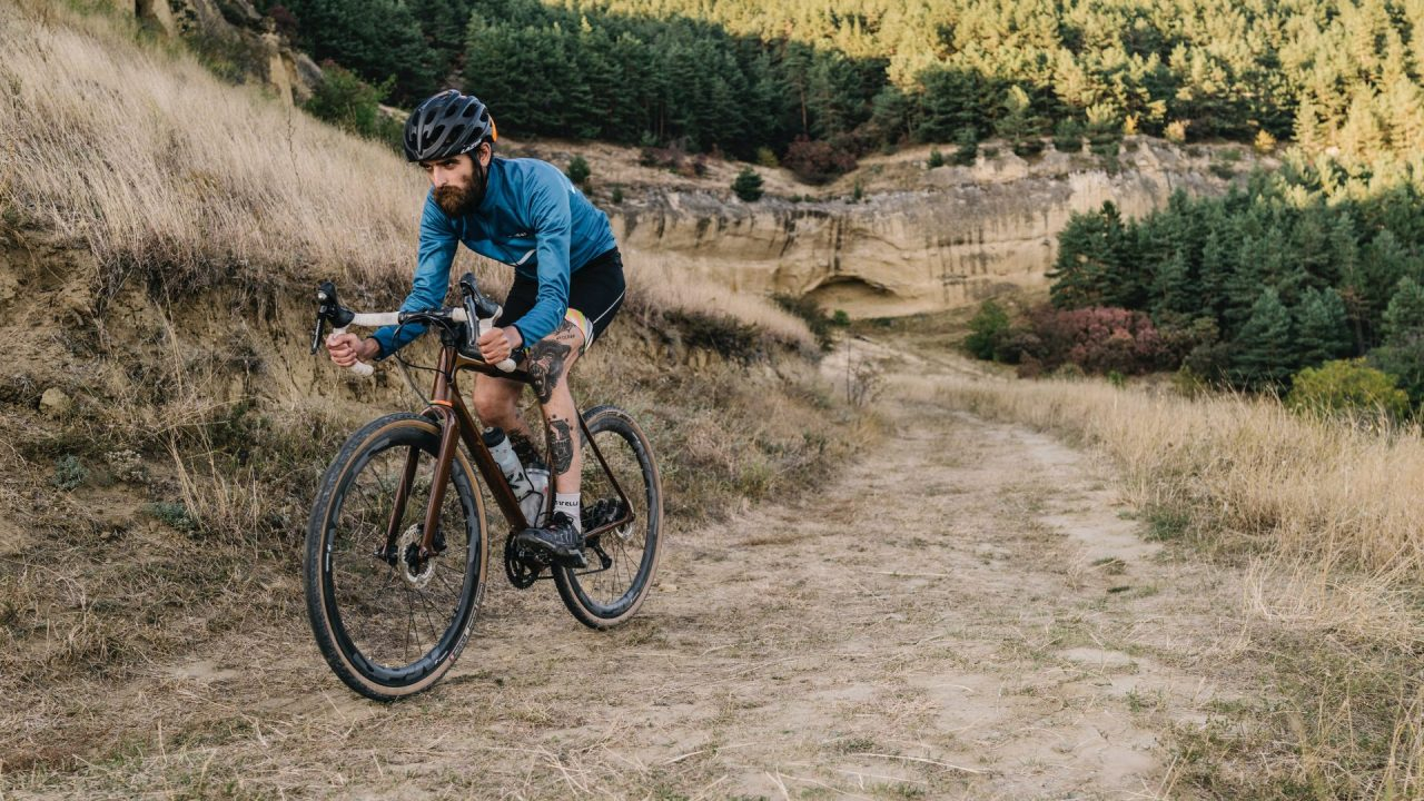 A cyclist is riding his gravel bike.